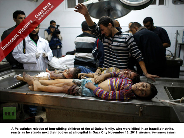A Palestinian relative of four sibling children of the al-Dalou family, who were killed in an Israeli air strike, reacts as he stands next their bodies at a hospital in Gaza City November 18, 2012.