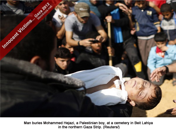 Man buries Mohammed Hejazi, a Palestinian boy, at a cemetery in Beit Lahiya in the northern Gaza Strip.