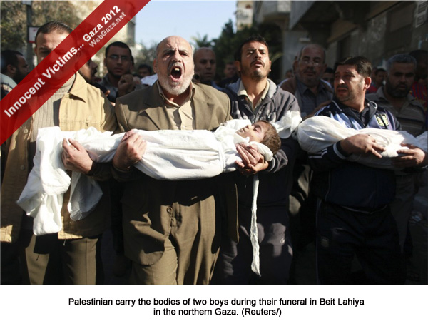 Palestinian carry the bodies of two boys during their funeral in Beit Lahiya in the northern Gaza.