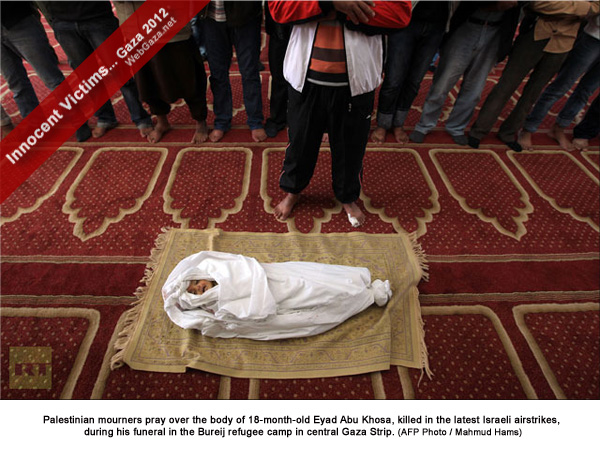 Palestinian mourners pray over the body of 18-month-old Eyad Abu Khosa, killed in the latest Israeli airstrikes, during his funeral in the Bureij refugee camp in central Gaza Strip.