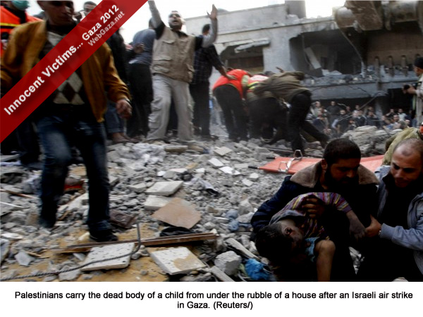 Palestinians carry the dead body of a child from under the rubble of a house after an Israeli air strike in Gaza.