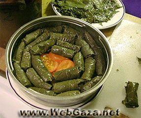 Mahshi Warak Enab (Stuffed Vine Leaves) - Arrange mahshi over layer of bones and sliced tomatoes and onion; Add water to cover, salt, and cook about an hour.