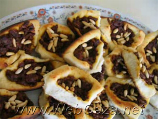 Sfeeha (Meat Pies) - Meat pies or Sfeeha is a popular snack that is prepared in the Middle Eastern kitchen. It has many variations of preparing and filling.